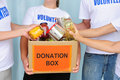 volunteers-putting-food-donation-box-17944652